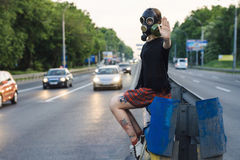 Ecological concept of air contamination. Woman in gas mask Stock Photos