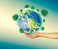 Ecological concept of the environment with the cultivation of trees on the ground in the hands. Planet Earth. Physical. Globe of the earth. . 3D illustration Stock Photos