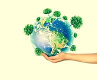 Ecological concept of the environment with the cultivation of trees on the ground in the hands. Planet Earth. Physical. Globe of the earth. . 3D illustration Royalty Free Stock Images