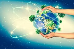 Ecological concept of the environment with the cultivation of trees on the ground in the hands. Planet Earth. Physical. Globe of the earth. . 3D illustration Royalty Free Stock Photo