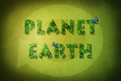 Ecological concept on green background with recycle sign Stock Photos