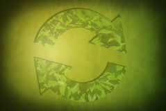 Ecological concept on green background with recycle sign Stock Photo