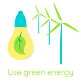 Ecological concept. Use green energy. An electric lamp with a green leaf inside. Wind turbines Stock Image