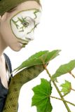 Ecological concept woman with green plant. Harmonic sensitive woman in actors green and white make-up with green leafs isolated on white background Stock Image