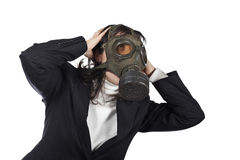 Ecological disaster. Business woman in gas mask isolated on white background royalty free stock photos