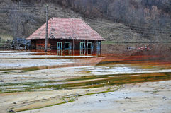 Ecological disaster. An abandoned village flooded by polluted wa Royalty Free Stock Photography