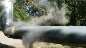 Ecological disaster. Industrial pipe emits clouds of smoke with combustion products into atmosphere. Closeup. Atmospheric pollution is associated with global stock video