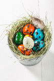 Ecological eggs for Easter on old white table Royalty Free Stock Photography