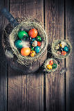 Ecological eggs for Easter in wooden small henhouse Stock Photos