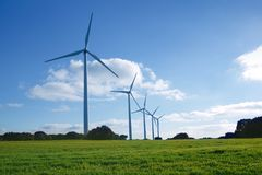 Ecological electric energy windmills in meadow Royalty Free Stock Images