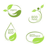 Ecological emblems set. Set of emblems, labels and frames with green leaves for ecological, organic or natural theme design Stock Image