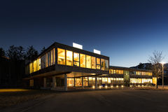 Ecological energy saving wooden office building. At night Stock Images