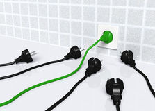 Ecological green plug into a white socket Stock Images