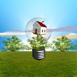 Ecological house. Light bulb with house and  ladscape background Stock Photo