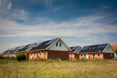 Ecological Houses With Solar Panels. Danish ecological housing with solar panels on roof Royalty Free Stock Images