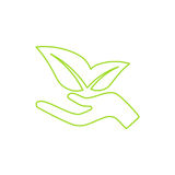 Ecological icon. Human hand growing green leaves. Stock Image
