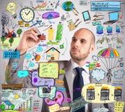 Ecological improvement plan. Businessman design an ingenious ecological improvement plan Stock Photography