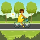 Ecological nature background with girl riding a bicycle Royalty Free Stock Image