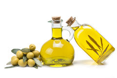 Ecological olive oil. Jars with olive oil and some olives isolated over a white background royalty free stock image