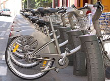 The ecological option. Bikes for rent in the street in Paris stock image