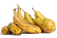 Ecological pears and bananas. Fruits harvested ecologically natural looking on a white background stock images