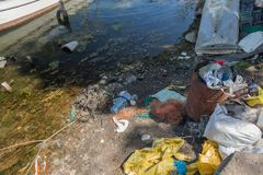Ecological problem. Rubbish in the water. Plastic bottles pollute nature. Bottles and garbage in the harbor of seaport of Varna. G. Arbage in the port, in water royalty free stock photos