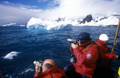 Ecological tourists from cruise ship Marco Polo in inflatable Zodiac boat in Errera Channel at Culverville Island, Antarctica Stock Photo