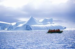Ecological Tourists In Inflatable Zodiac Boat In Errera Channel At Culverville Island, Antarctica Royalty Free Stock Photos