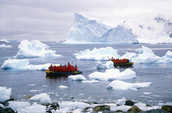 Ecological tourists in inflatable Zodiac boat in Paradise Harbor, Antarctica Stock Photography