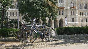 Ecological transportation. Bicycle parking. Bicycle parking in front of european castle. Beautiful architecture and tourist destination. Bike trip stock video