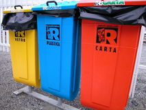 Ecological trash. Three recycling bin for cans, plastic and paper, Italy Royalty Free Stock Photo