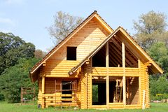 Ecological wooden cottage Stock Photos