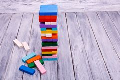 Ecological wooden game Janga or tower. Entertainment activity. Game of physical and mental skill. stock photography