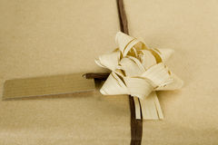 Ecological wrapped present. Beautifully naturally wrapped gift with name tag stock photo