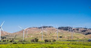 Modern green energy-saving technologies. Wind Power Station in California. Ecologically clean electricity production. High modern windmills in rural California Stock Images