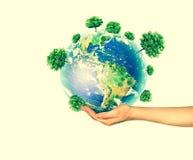 Ecologisch concept het milieu met de cultuur van bomen ter plaatse in de handen De achtergrond is volledig met sterren fysiek Royalty-vrije Stock Afbeeldingen