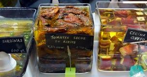 Ecologische droge tomaten in glaskruik Stock Fotografie