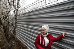 The ecologist Evgenia Chirikova near a fence of a cottage of the governor Tkachyov in the protected wood Royalty Free Stock Photos