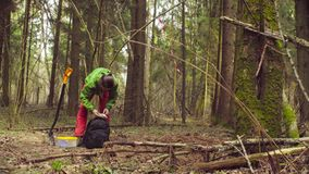 The ecologist looking for a place of research. A woman scientist ecologist in the forest opening and unpacking a backpack stock video