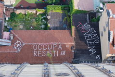 Ecologist protest against High Speed Train, Italy. Phrases of protest written on a roof against the TAV in Turin, Italy Stock Images