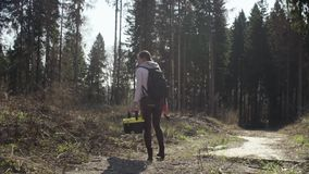 Ecologist on road near the forest felling stock video
