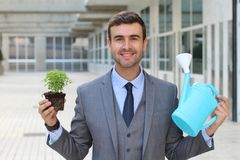 Ecologist about to take care of a plant Stock Photos