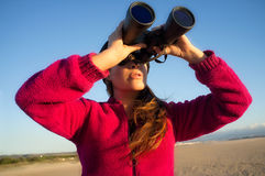 Ecologist Woman Watching the Environment with Binoculars Royalty Free Stock Photo