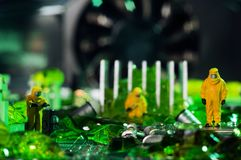 Environmental pollution concept. The ecologists or technicians cleaning toxic or radioactive waste on motherboard.  Environment pollution concept. Selective Stock Image