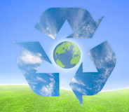 Ecology. Concept for ecological purposes. Recycling symbol over a green and blue background royalty free illustration