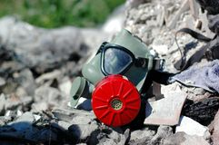 Ecology. Gas mask on a dump. Ecology and pollution concept Royalty Free Stock Photography