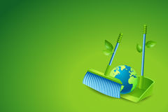 Ecology Background Concept : Green broom sweeping globe to dustpan. Royalty Free Stock Image