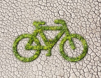 Ecology bike from grass on cracked earth background Royalty Free Stock Images