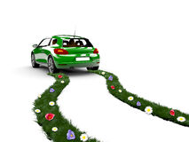 Ecology car. A green car drive and create grass with flowers Stock Photo