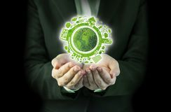 Ecology concept design. Business woman hands holding world ecology design Royalty Free Stock Photography